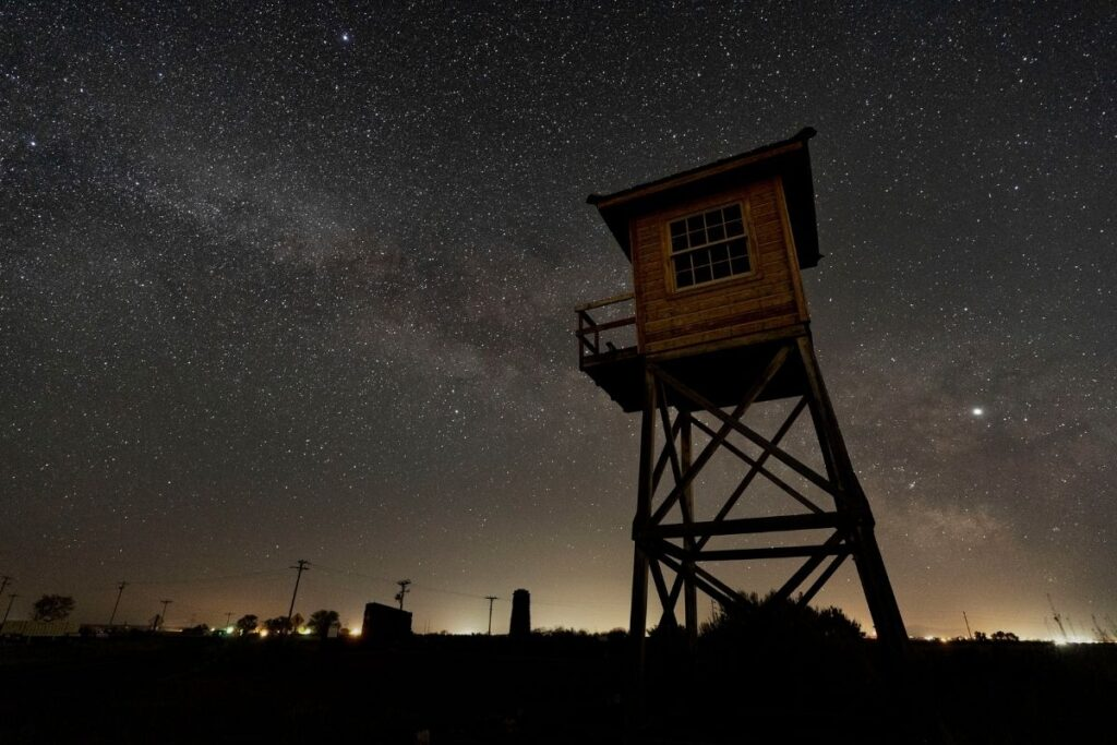 A starry sky and a guard tower in the forground