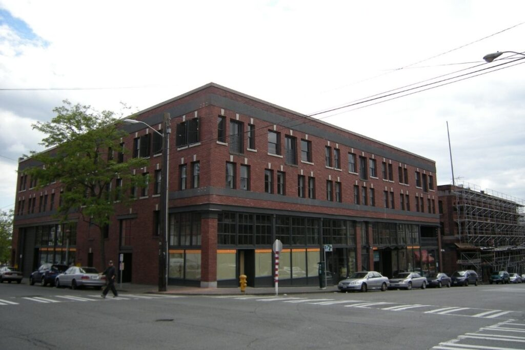 A brick building with lots of windows