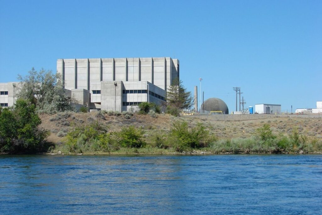 A large concrete building overlooking the river