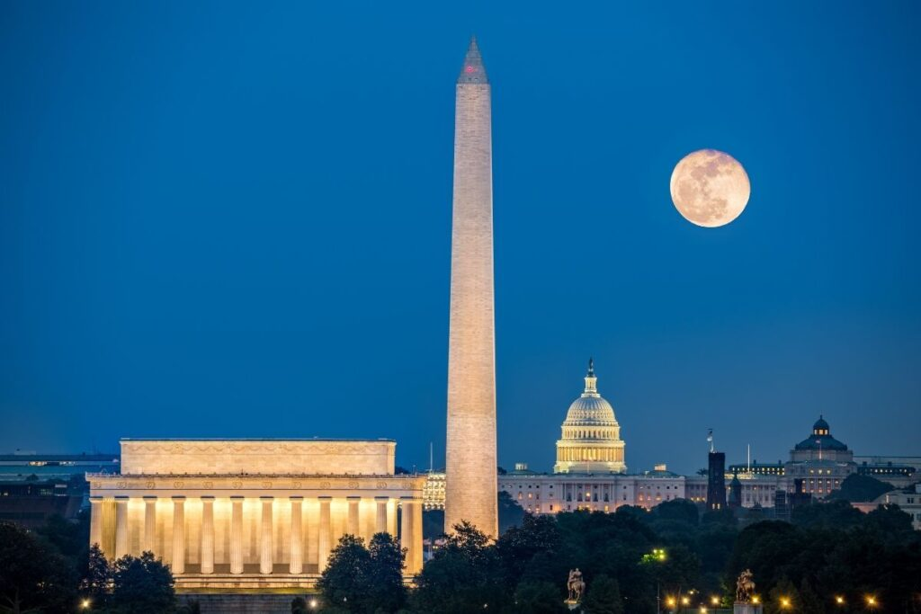 Lincoln Memorial and the Washington Monument with the Capitol Building and the moon in the background