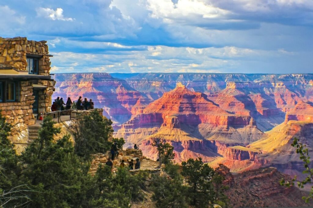 A group of people looking out across a massive canyon