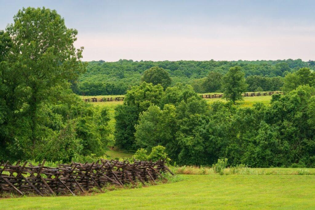 open fields with a split-rail fence.