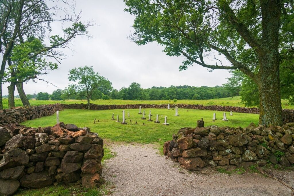 A small cemetery surrounded by a rock wall
