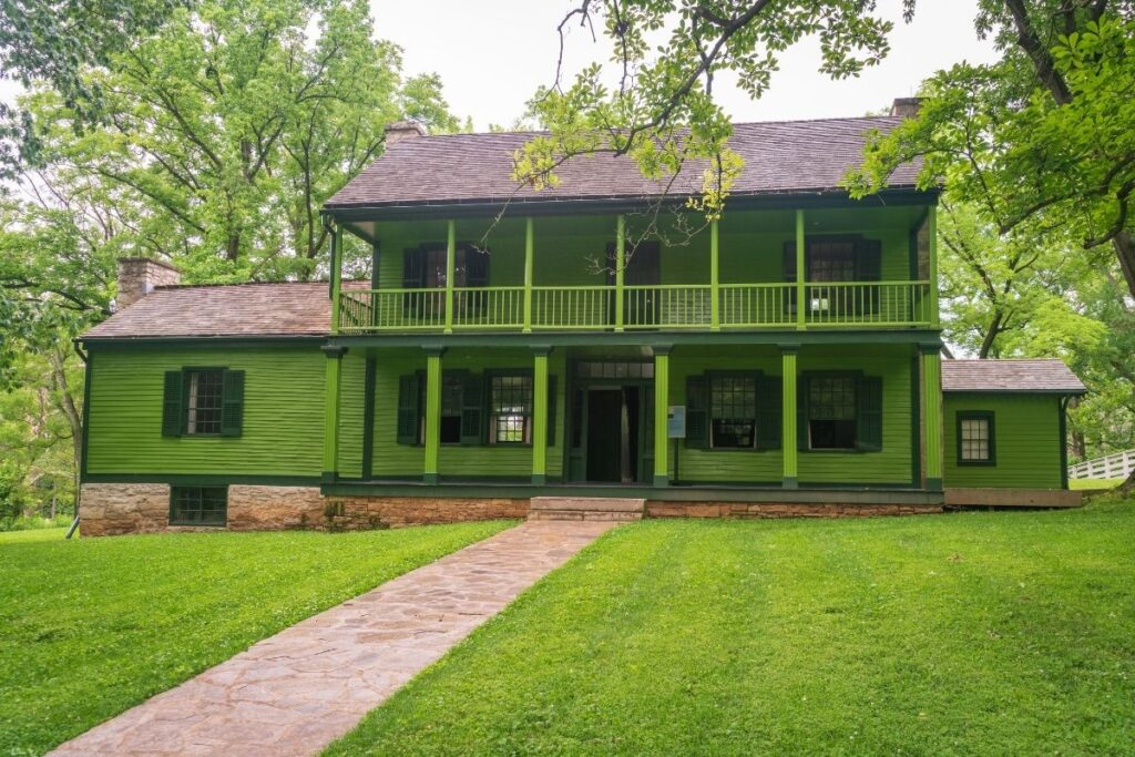 A green two story house