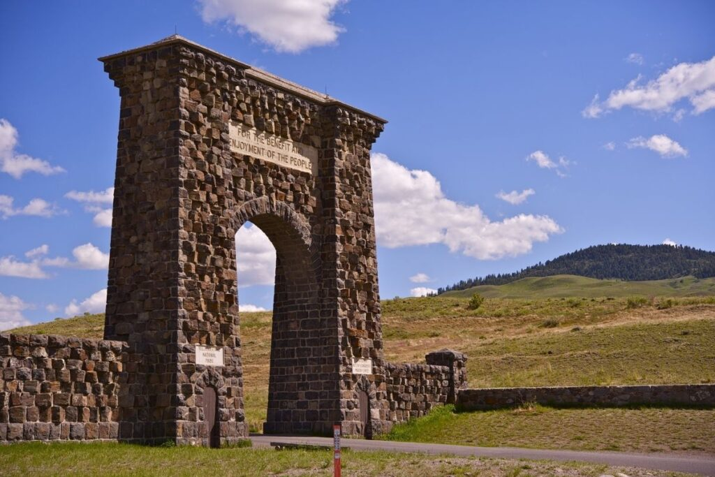 """A manmade arch that reads """"For the Benefit and Enjoyment of the People"""""""
