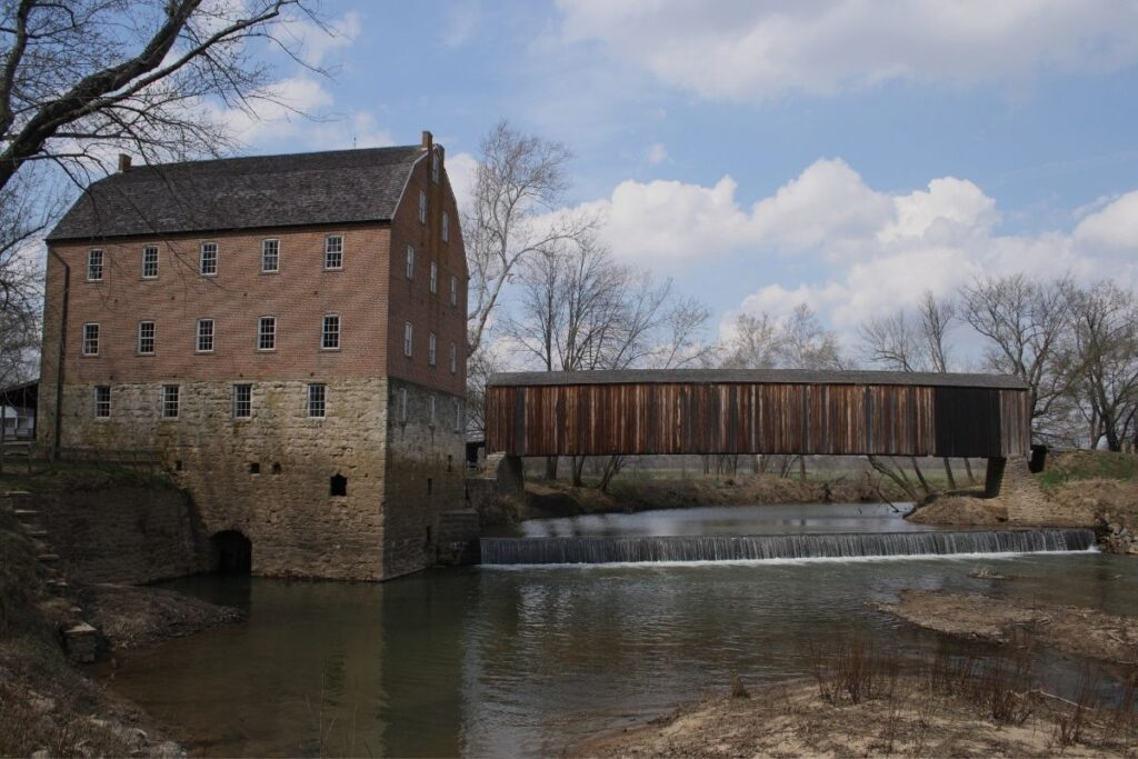 A brick mill located on a river.