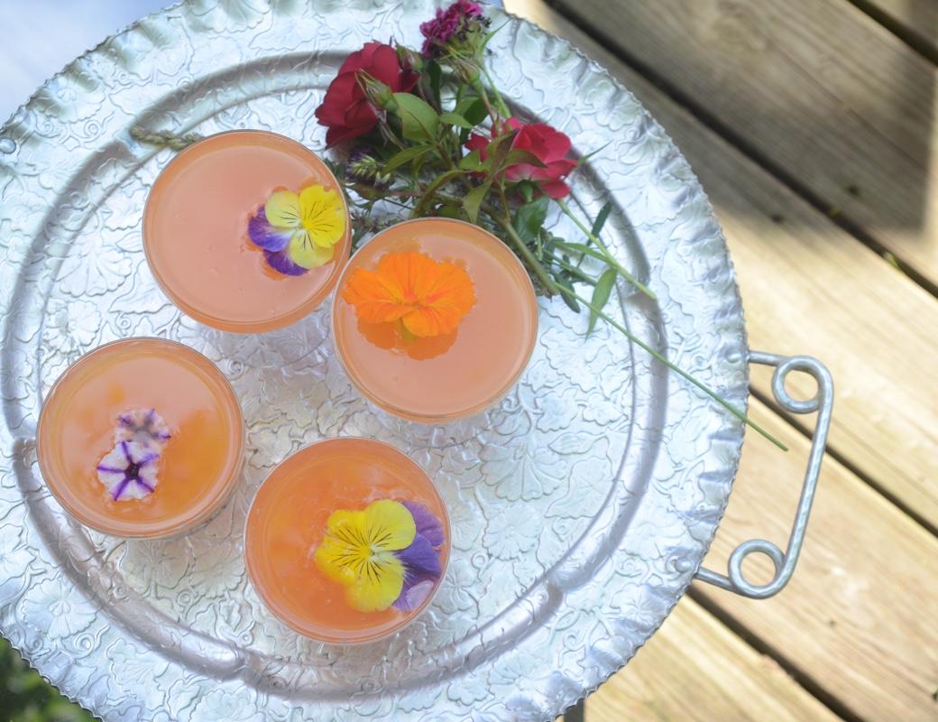 Vodka Aperol Tangerine Lime Cocktail with Edible pansies