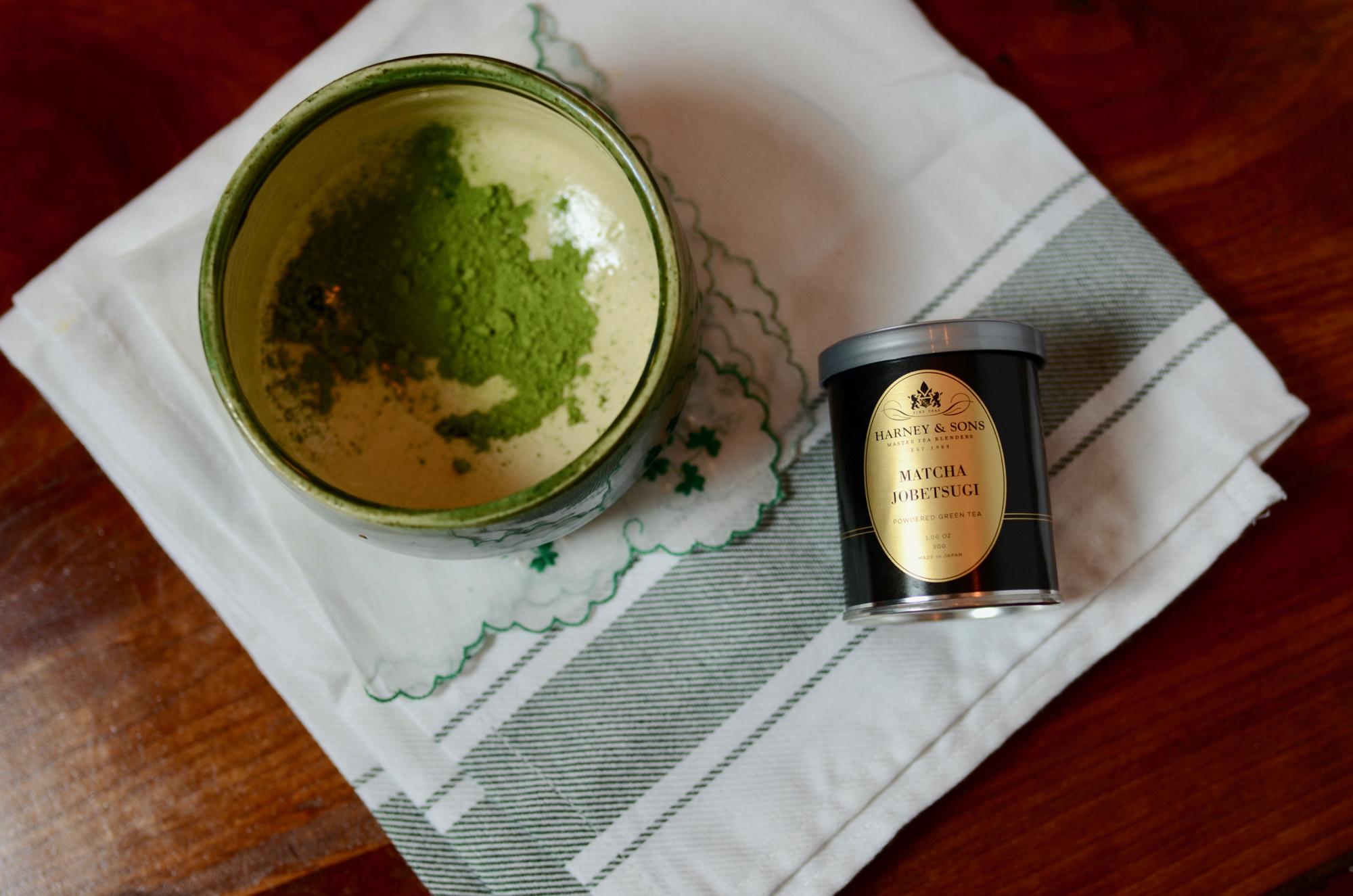 Green matcha powder in a ceramic bowl