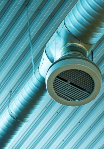 Industrial ventilation system pipes on warehouse ceiling