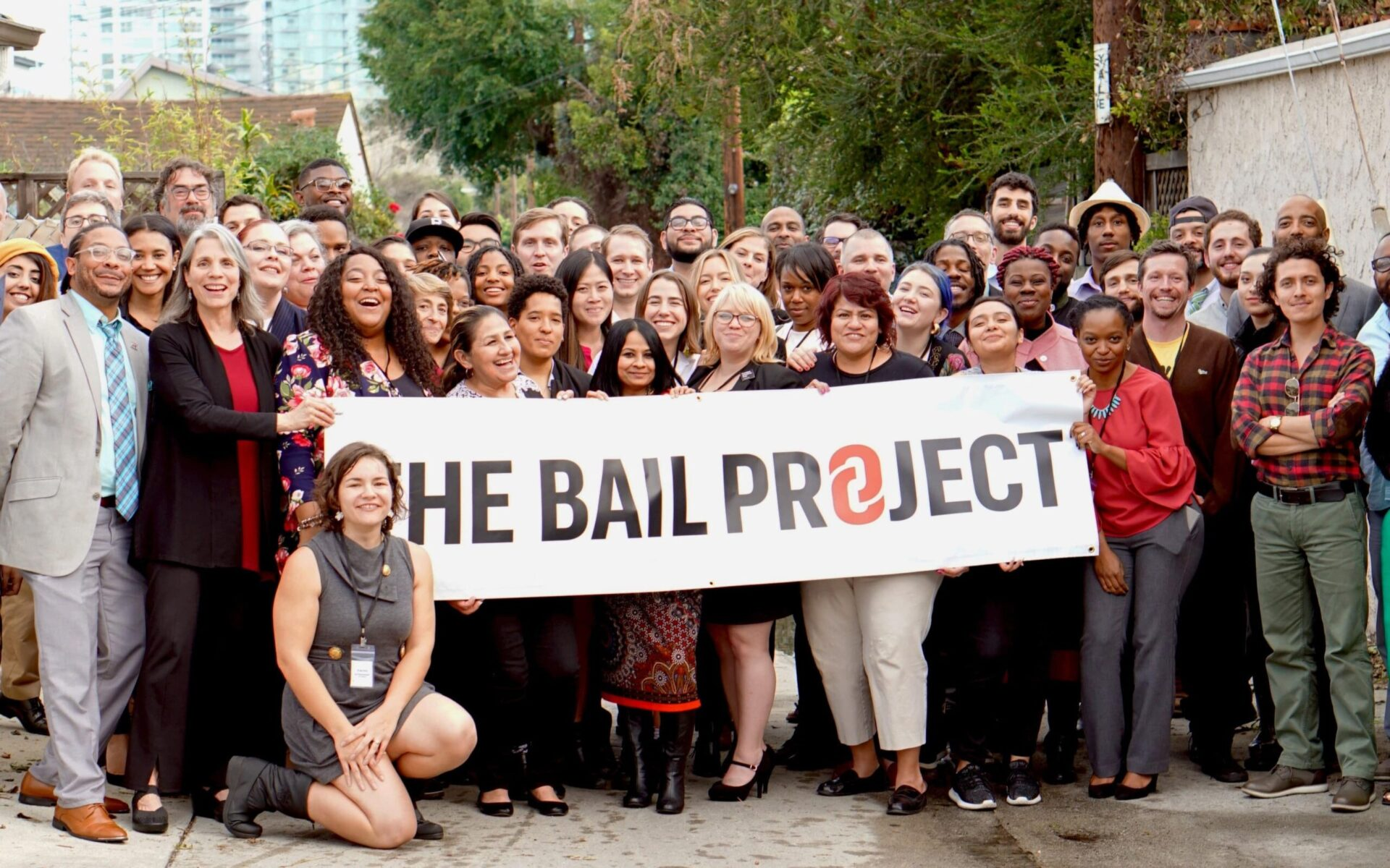 group of people holding the bail project tarpaulin