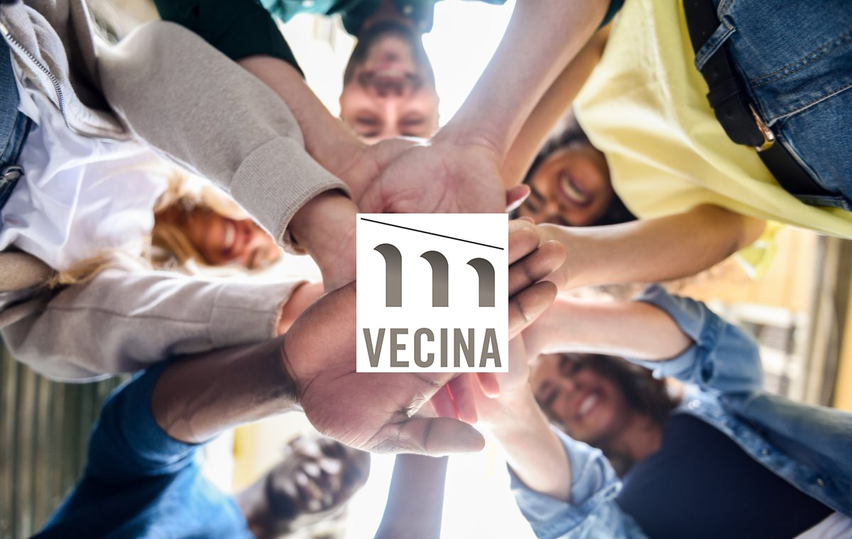 group of people hand in hand in vecina