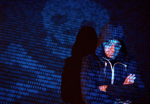 cyber-attack-with-unrecognizable-hooded-hacker-using-virtual-reality-digital-glitch-effect