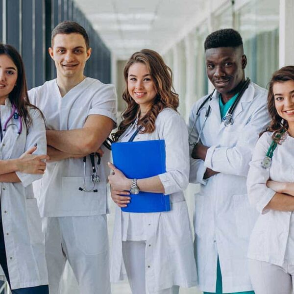 team-of-young-specialist-doctors-standing-in-the-corridor-of-the-hospital-min