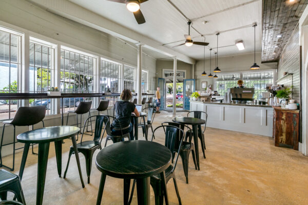 Woman working remotely in Old Road Coffee Shop in New Orleans LA
