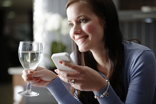 Image: Woman Texting and Drinking Wine