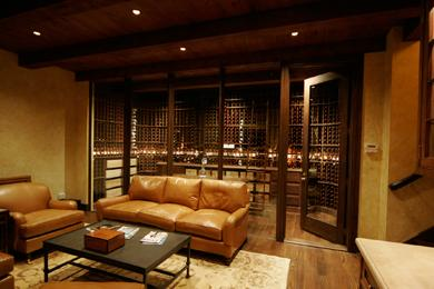 Image: Sitting Room with Clear Door Displaying Wine Cellar
