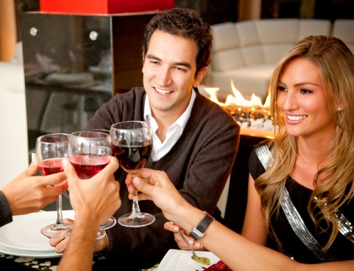 Image: Group of friends having dinner in an elegant restaurant toasting with wine