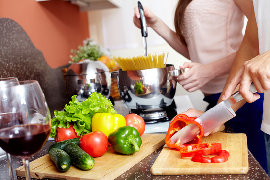 Image: Close-up of Woman Chopping Vegetables and Wine Glass