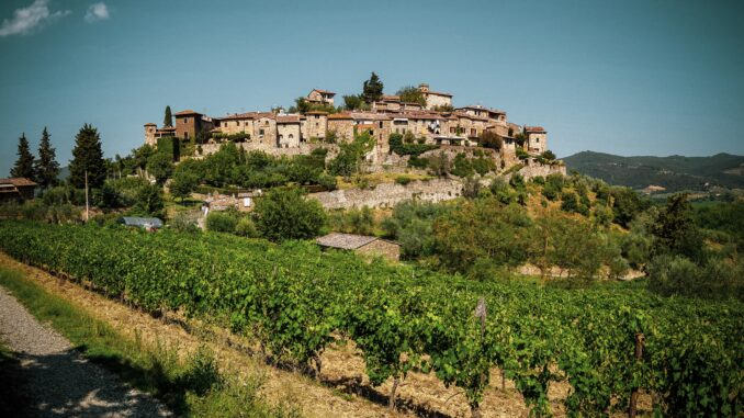 Picturesque Tuscan Landscape with medieval town and vineyards