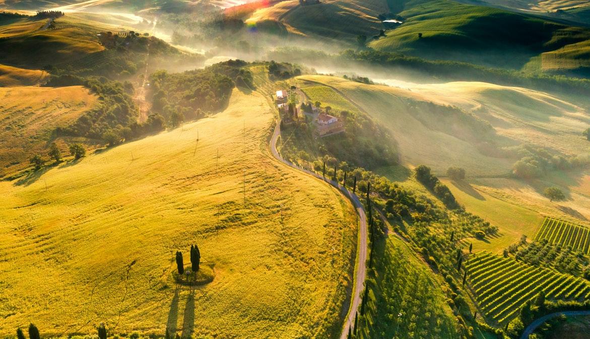 Tuscan hillside winery at sunset
