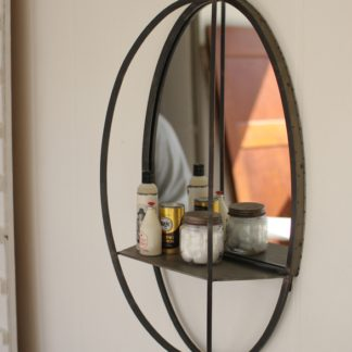 oval mirror with shelf