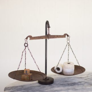 antique metal scale with weighted base
