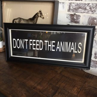 DON'T FEED THE ANIMALS Framed Print