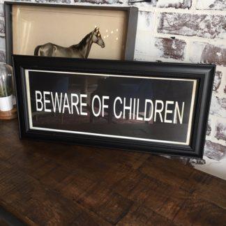 BEWARE OF CHILDREN Framed Print