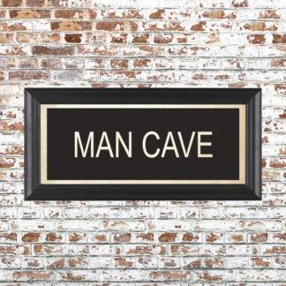 MAN CAVE Framed Print