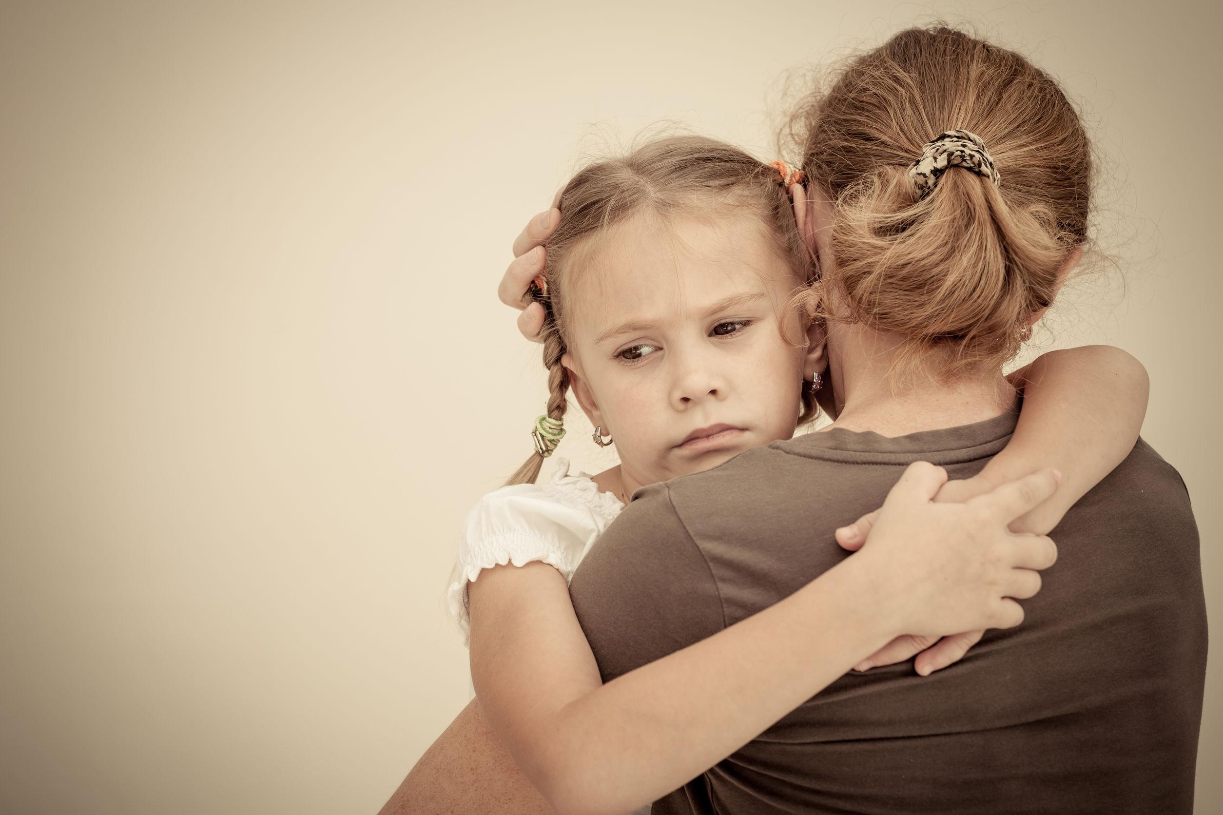 27421952 - sad daughter hugging his mother
