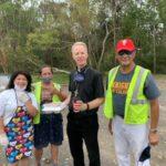 Bishop and Volunteers at Hot Meal Food Distribution