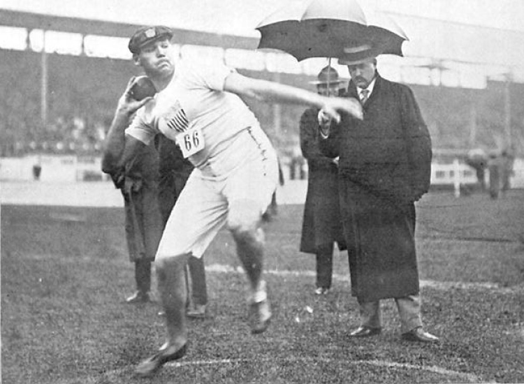"""Shot put competition, Summer Olympics 1908 in London.  Source: Illustration in the """"Fourth Olympiad 1908 London Official Report"""" published by the British Olympic Association in 1909"""