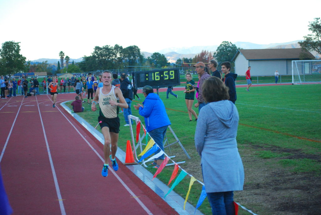 Lawson moves from 4th to 2nd over last half mile to finish in 17:01.