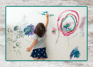 toddler painting on the wall
