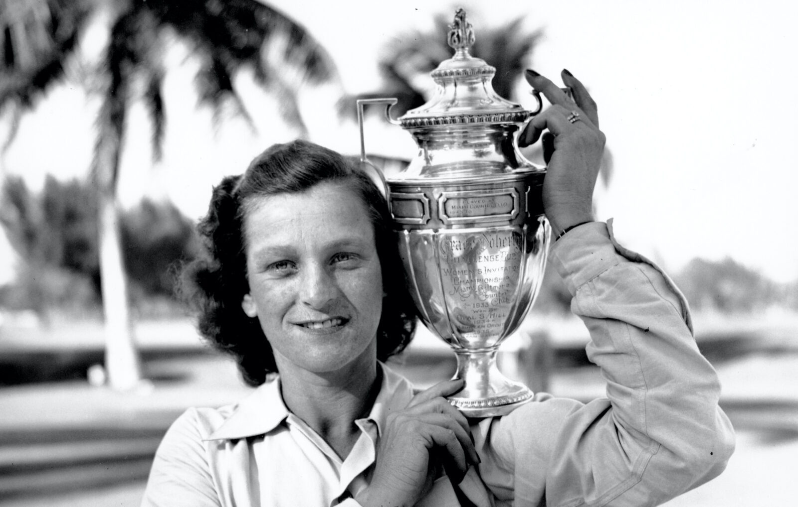 Babe Didrikson Zaharias poses with her trophy at the Miami Biltmore Country Club in Miami, Fl. on Feb. 1, 1947. Zaharias was presented the challenge cup for winning the Helen Lee Doherty Women's Invitational Championship golf tournament. (AP Photo)