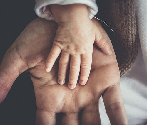 A parent and childs hand display the bond of family through holding hands from training at The PAC Program Outpatient Addiction Treatment Non OASAS Parenting Educational Life Skills Training Groups