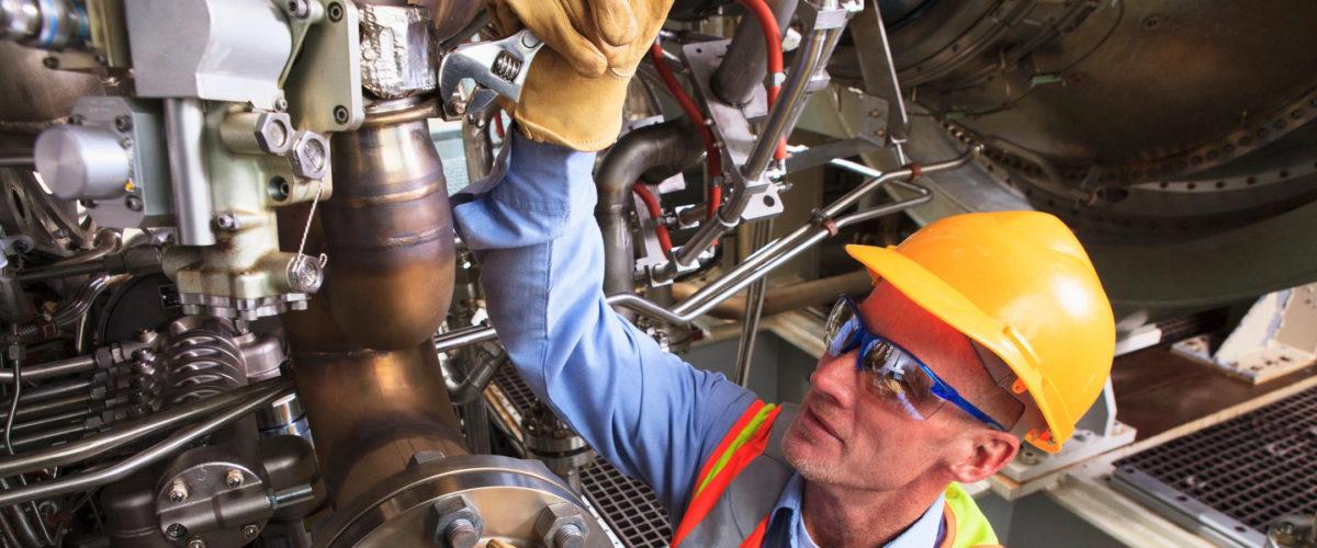 EBS-Man working on big machine-900