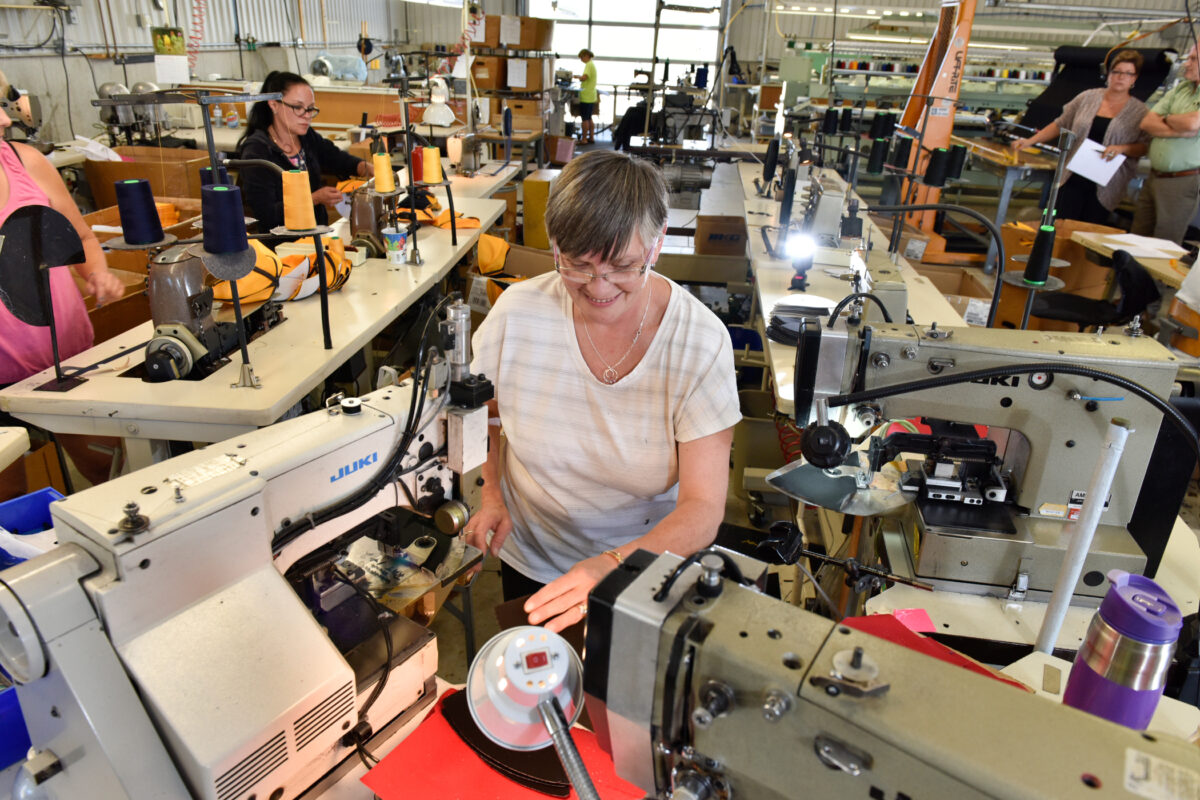 Union worker at sewing machine-2100