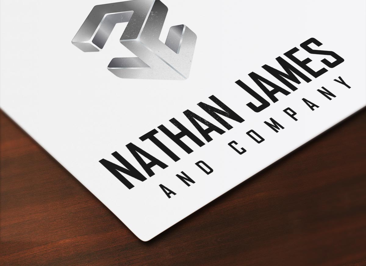 Nathan James and Company Logo Mocked up on paper on wood desk