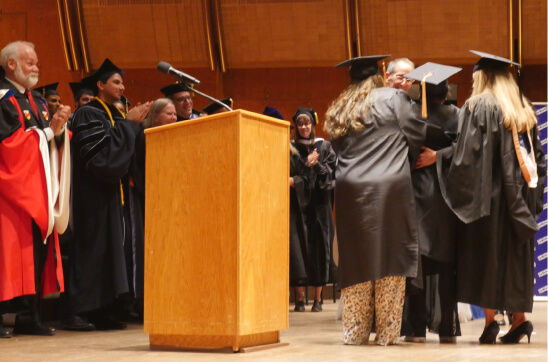 Shontae Ferguson, receives her diploma while in labor at graduation