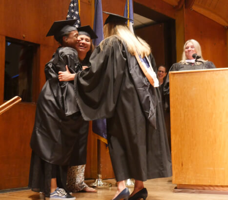 9 months pregnant, and in labor, Shontae Ferguson proceeds with aides to get diploma at graduation