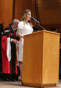 MC Alyse Zwick at graduation commencement