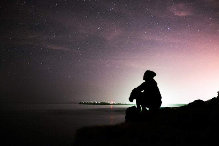man sitting outside at night