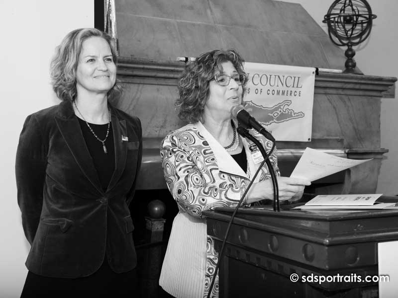 women speaking at podium