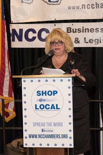 Julie Marchesella speaking at podium