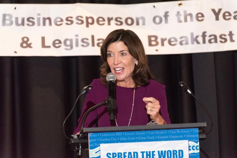 a woman speaking at podium