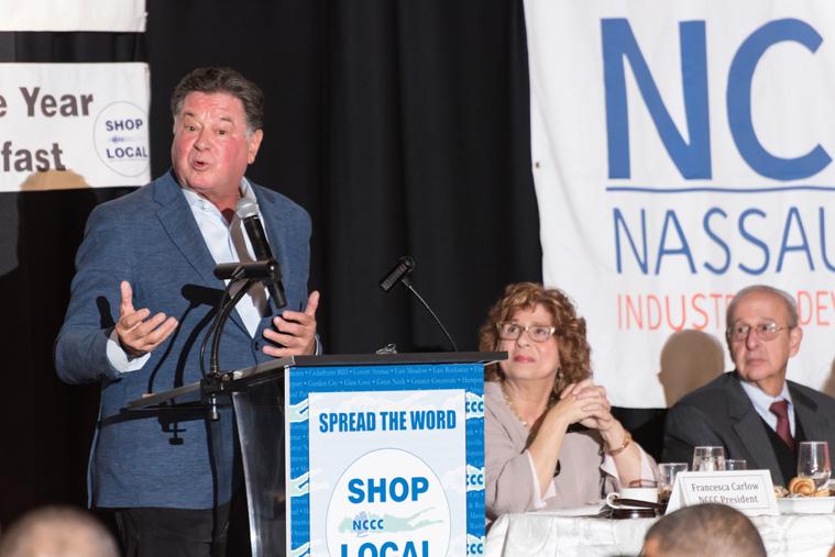a man speaking at podium