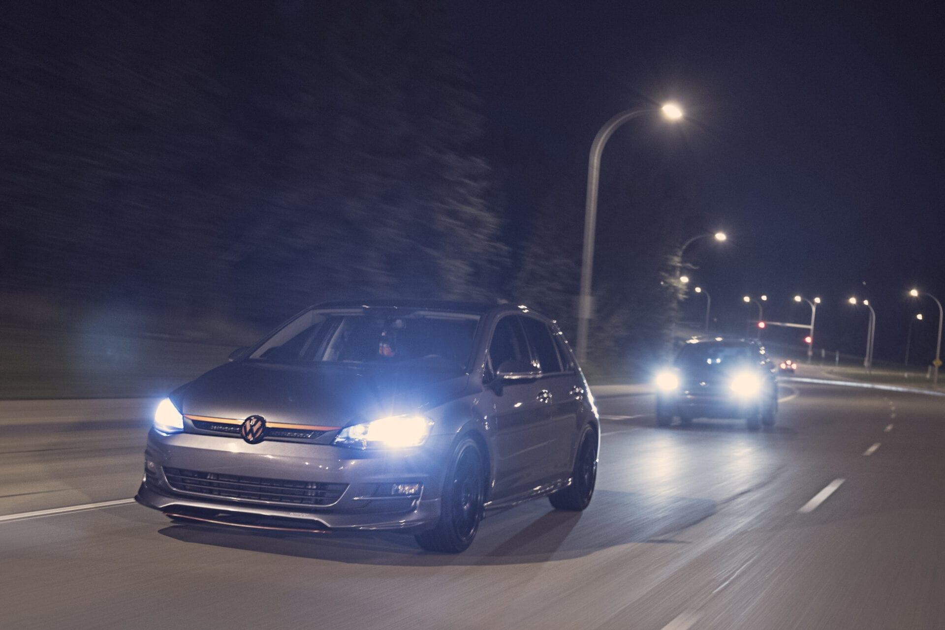 VW Golf driving under a bridge at fox drive in Edmonton at night