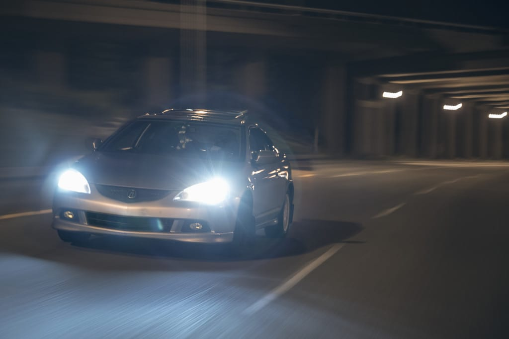 Acura RSX driving down fox drive in Edmonton at night