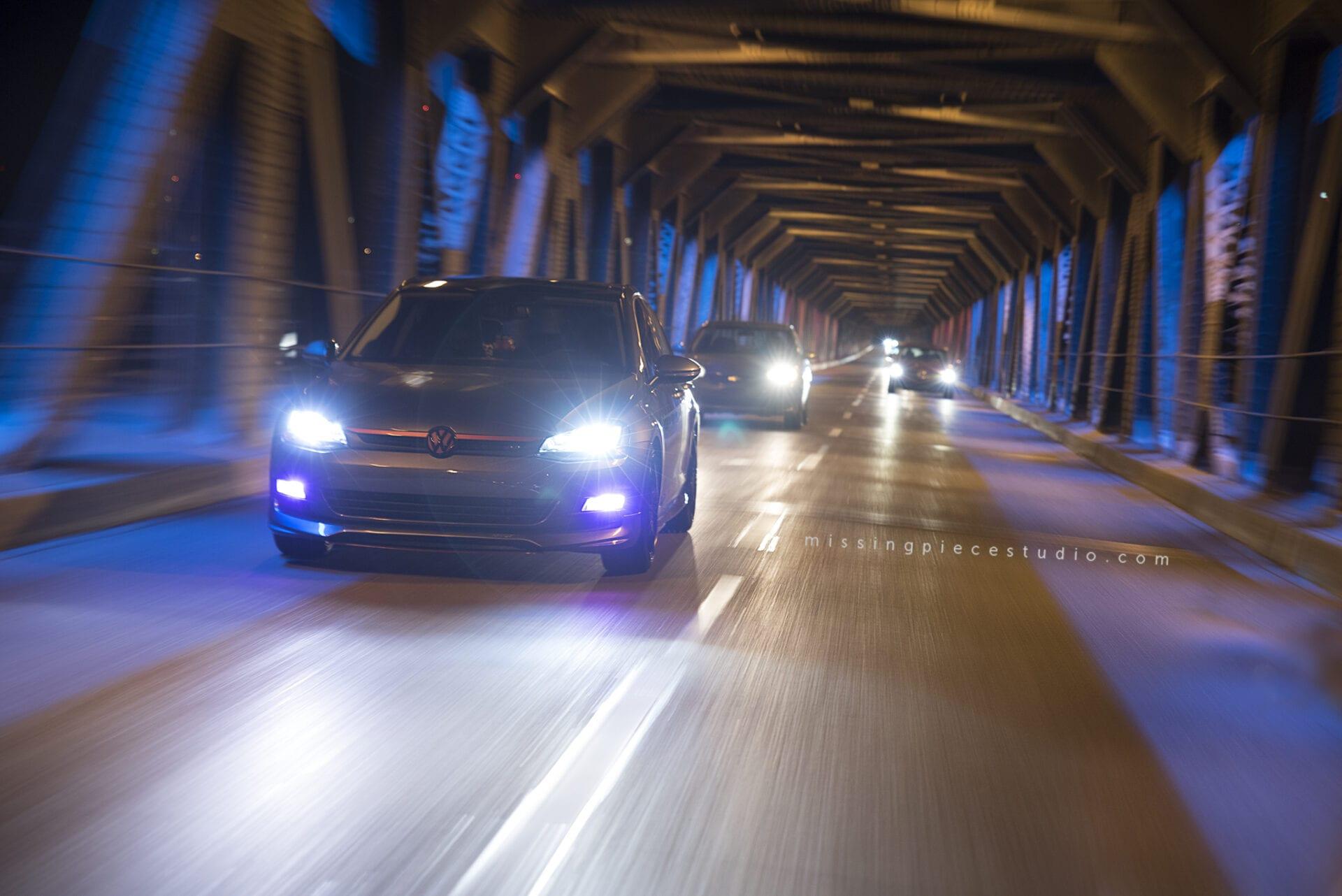 A beautiful VW golf driving down low high bridge in Edmonton
